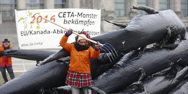 Attac-Aktivist_innen bei einem Anti-Ceta-Protest im Januar 2016, Quelle: taz, Foto: Reuters