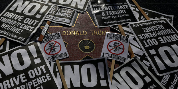 Trumps Hollywood-Stern bedeckt mit NO-Plakaten