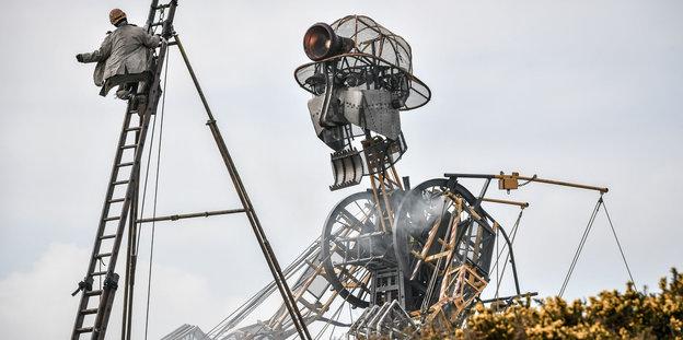 Eine menschförmige Riesenmaschine