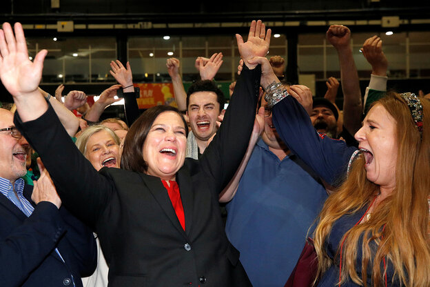 Sinn Fein chairman Mary Lou McDonald celebrates the election victory with her hands up.
