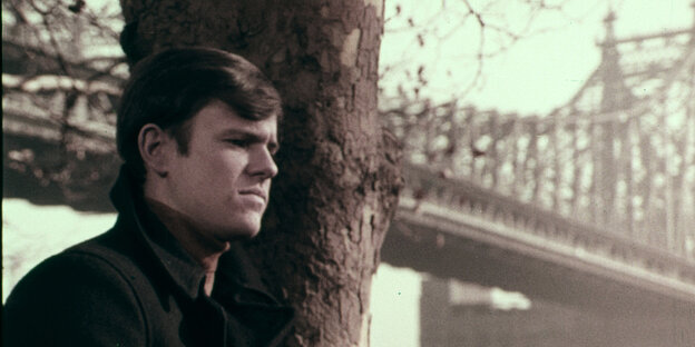 Portrait of Craig Smith - in the Background a bridge
