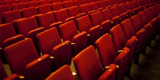 Empty rows of seats in a theater.