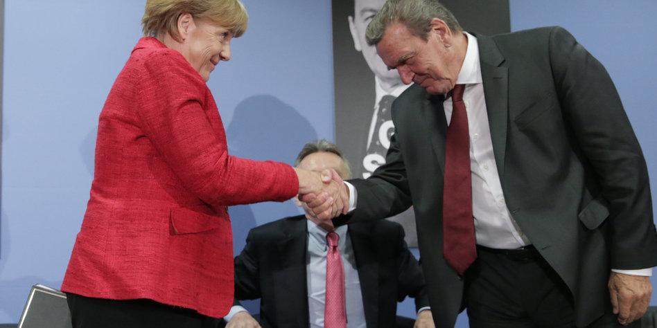 angela merkel schttelt gerhard schrder die hand - Gerhard Schrder Lebenslauf