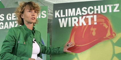Green national campaign manager Steffi Lemke in front of a party campaign poster saying climatic protection works